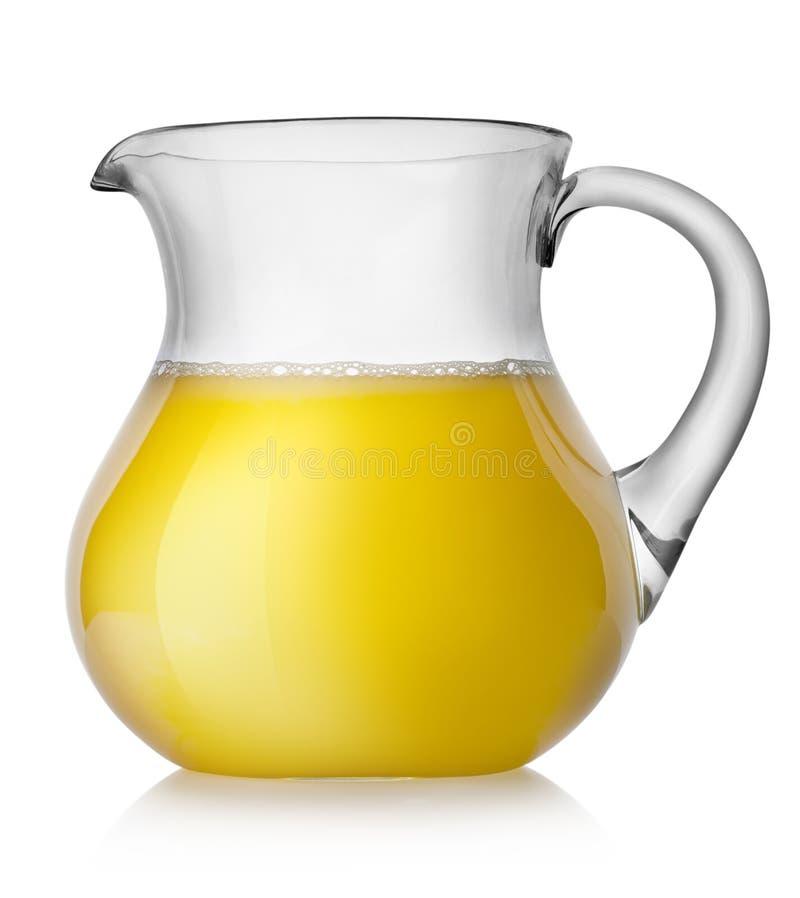 Orangensaft in einem Krug lizenzfreie stockfotos