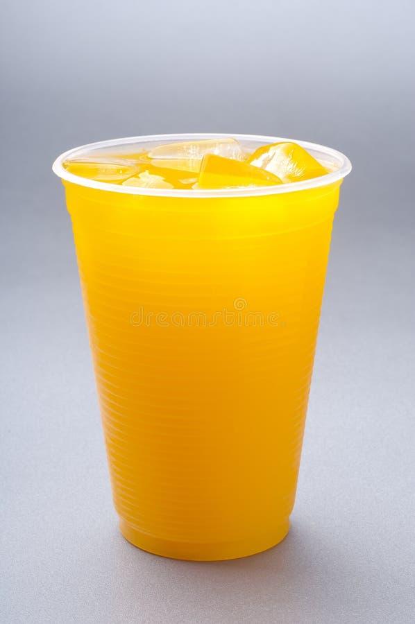 Orangensaftcup lizenzfreies stockfoto
