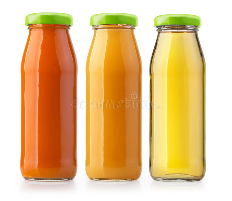 Orangensaftflaschen lokalisiert stockfotografie