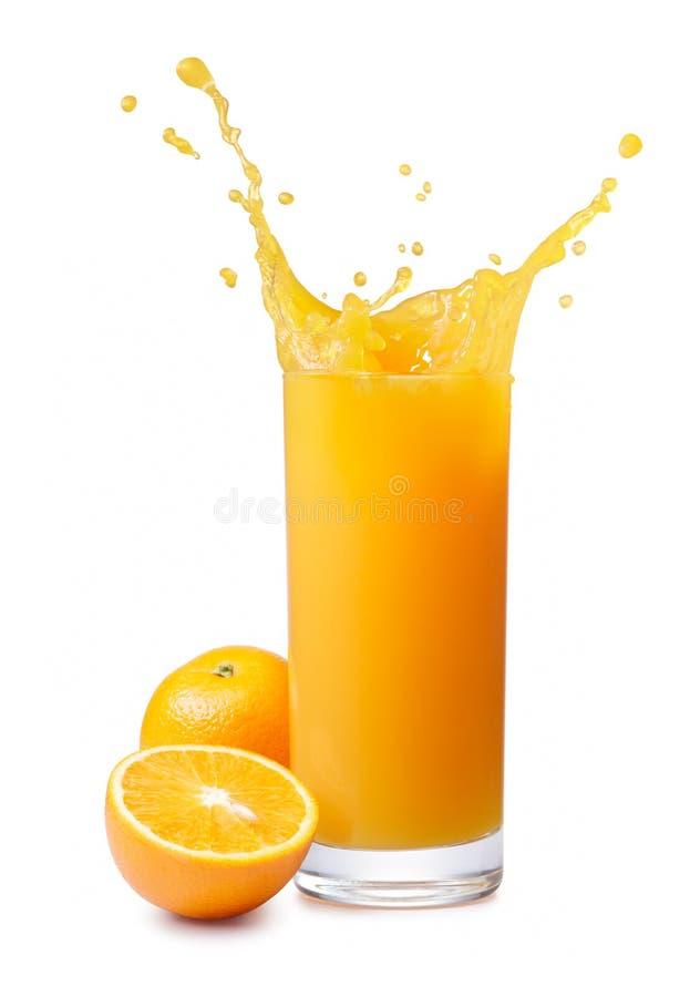 Orangensaftspritzen lizenzfreie stockbilder