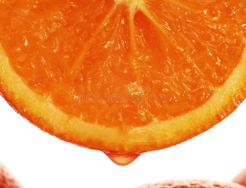 Orangensafttropfen lizenzfreie stockbilder