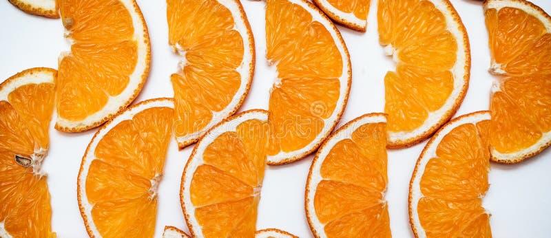 Orangenscheiben - köstliche essbare Hintergrundgrenze lizenzfreie stockfotos