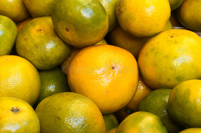 Oranges. The background of fresh oranges stock photo