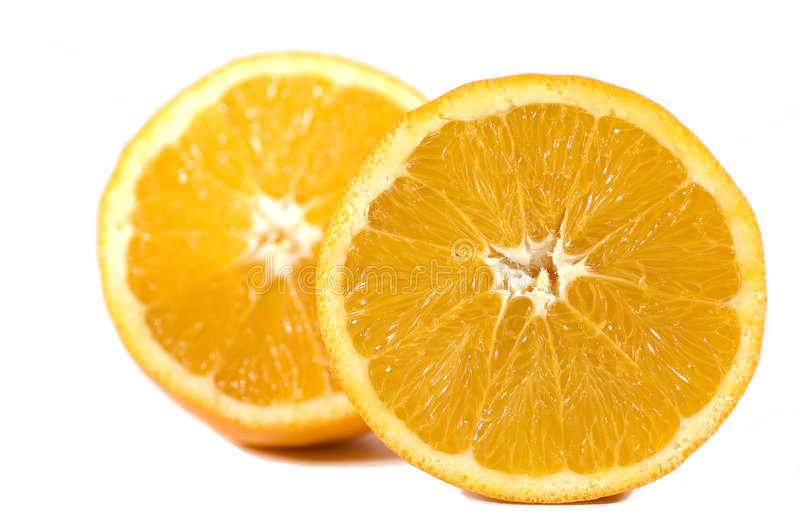 Oranges. An orange in two halves stock photography
