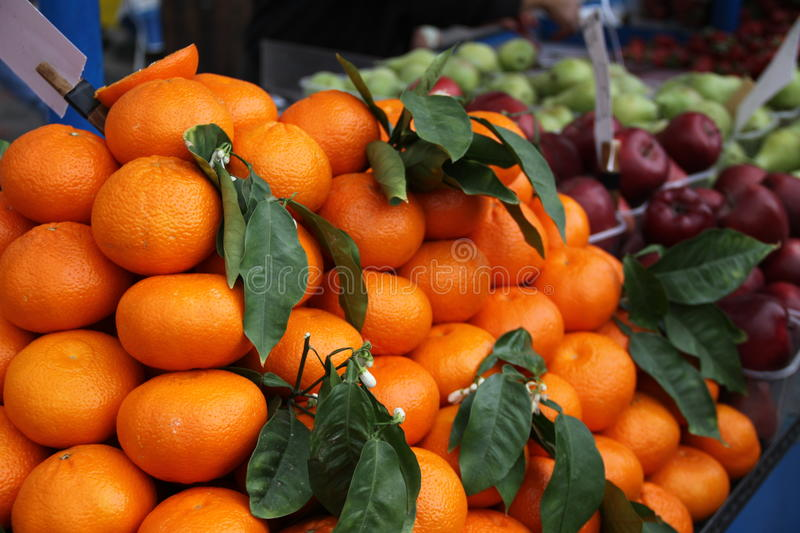 Oranges and apples in a Greek market royalty free stock image