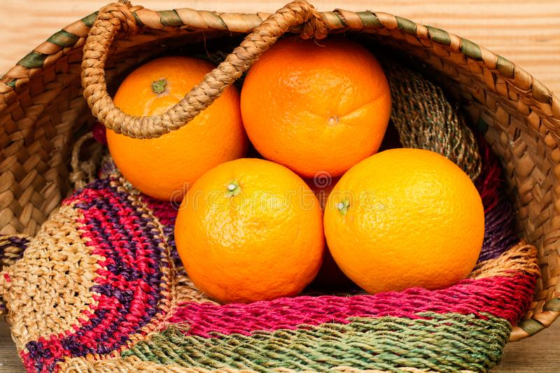 Oranges in a bag made with esparto royalty free stock photography
