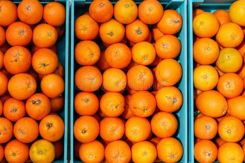 Oranges in blue boxes in fruit shop. Eilat, Israel royalty free stock photos