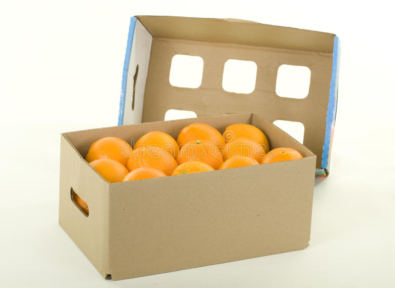 Oranges in Box with Cover. Fresh oranges in box with cover; studio isolated royalty free stock images