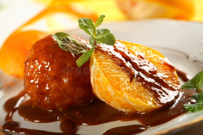 Oranges in chocolate dressing royalty free stock photography