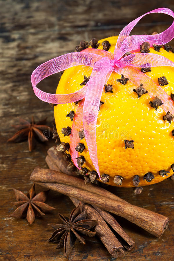 Oranges with cloves and cinnamon sticks stock images