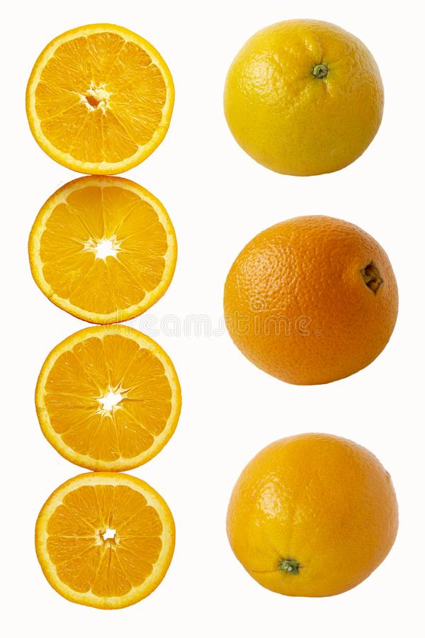 Oranges cut into round slices and whole fruits isolated on white background. Tropical fruit. Oranges cut into round slices and whole fruits isolated on white royalty free stock photo