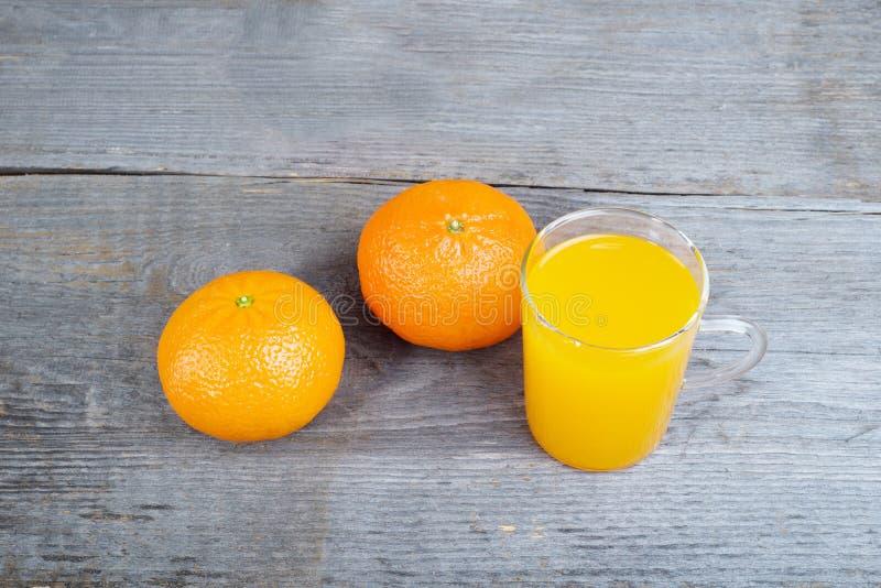 Oranges et jus d'orange images libres de droits