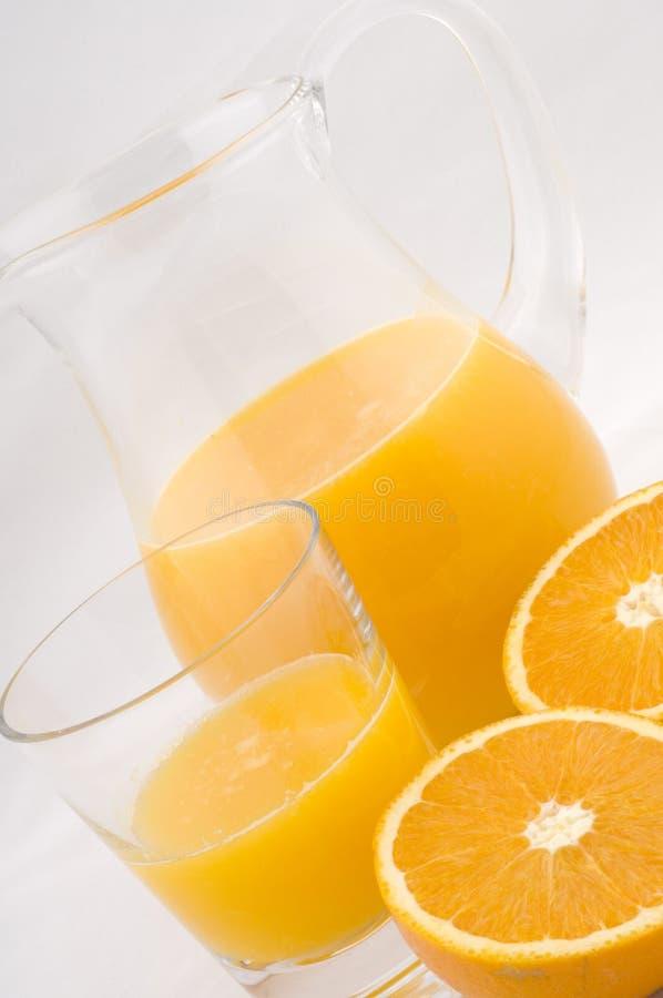 Oranges et jus frais photographie stock libre de droits