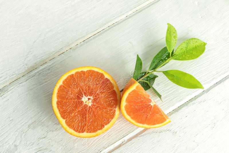 Oranges with fruits on the table stock photography