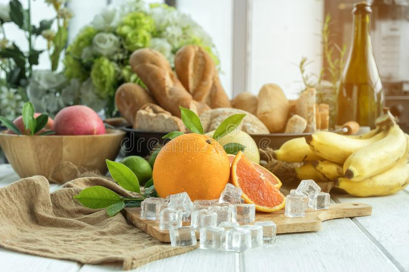 Oranges with fruits on the table stock photos