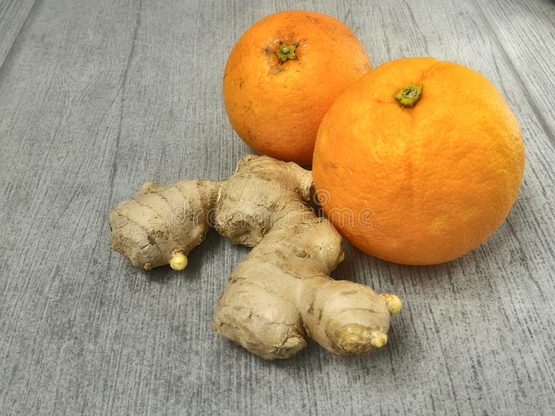 Oranges and ginger root on wood stock image