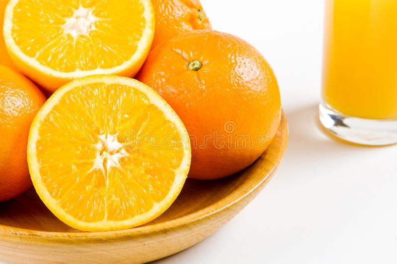 Oranges with a glass of orange juice stock photos