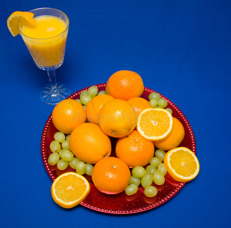 Oranges and Grapes royalty free stock photography