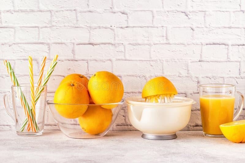 Oranges and juicer for making orange juice. stock images