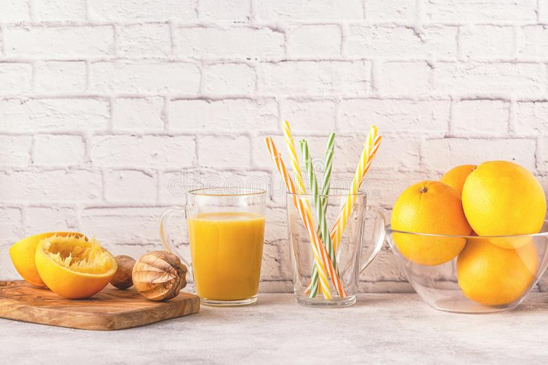 Oranges and juicer for making orange juice. stock photography