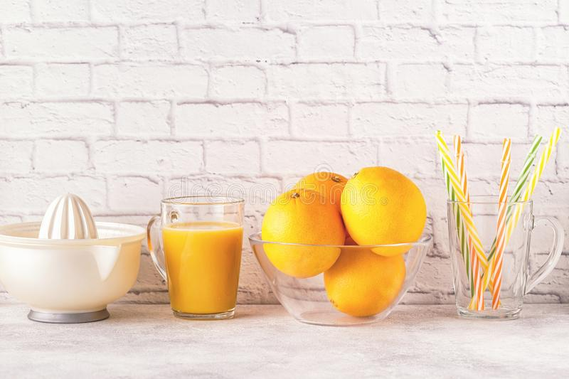 Oranges and juicer for making orange juice. stock photos
