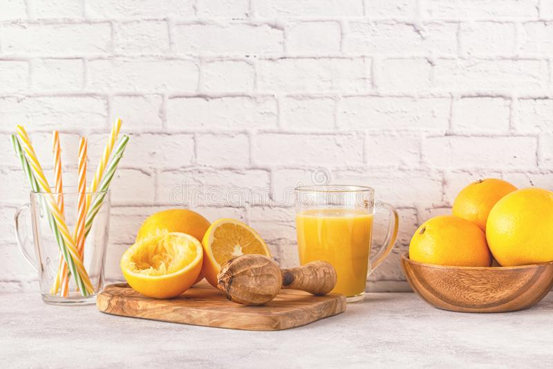 Oranges and juicer for making orange juice. royalty free stock photography