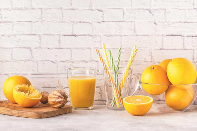 Oranges and juicer for making orange juice. stock photos