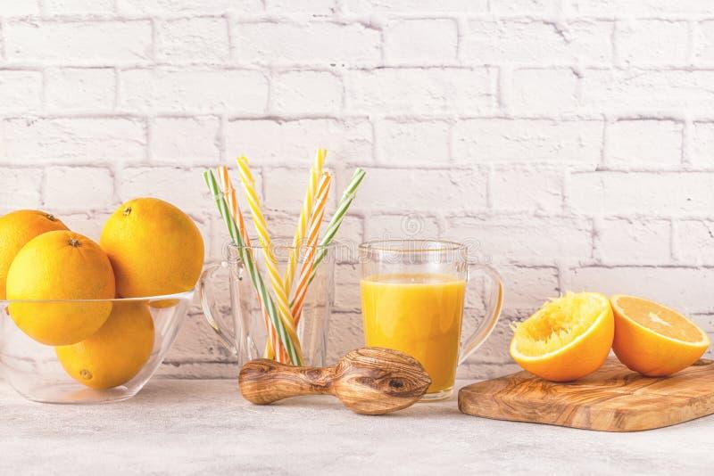 Oranges and juicer for making orange juice. royalty free stock images