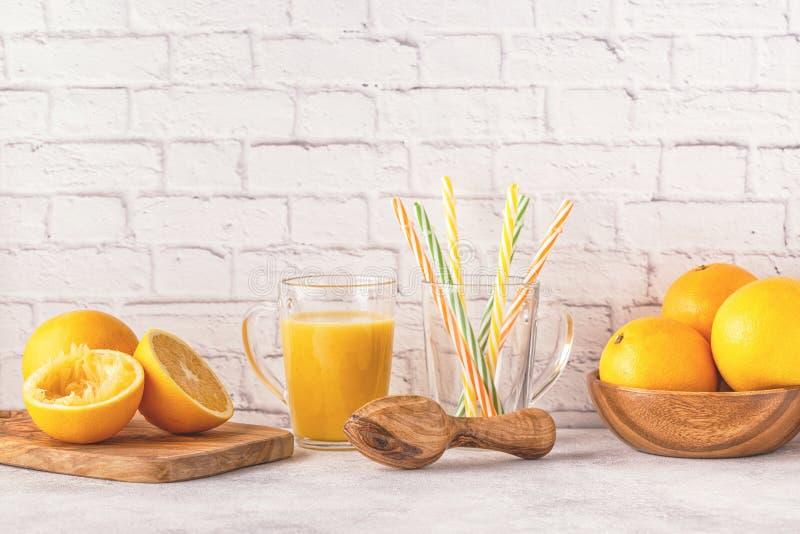 Oranges and juicer for making orange juice. stock image