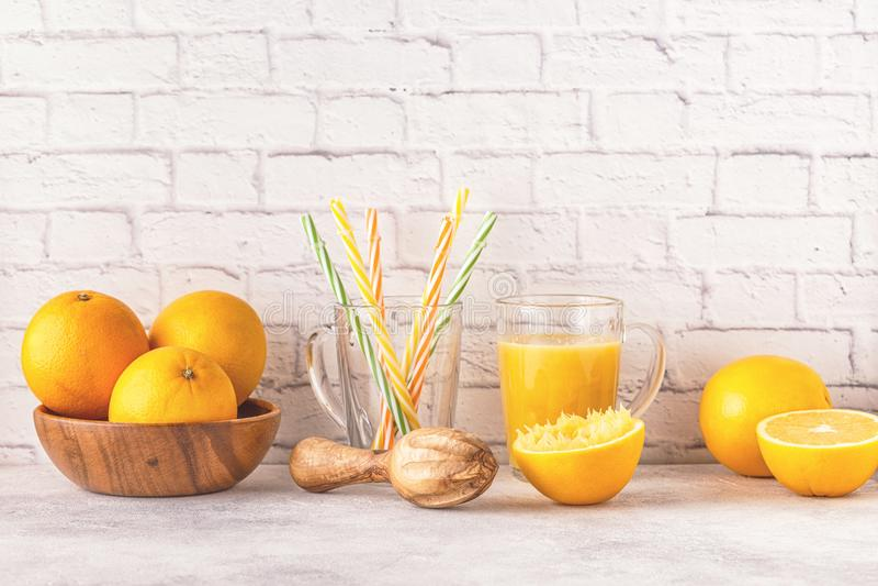 Oranges and juicer for making orange juice. royalty free stock image