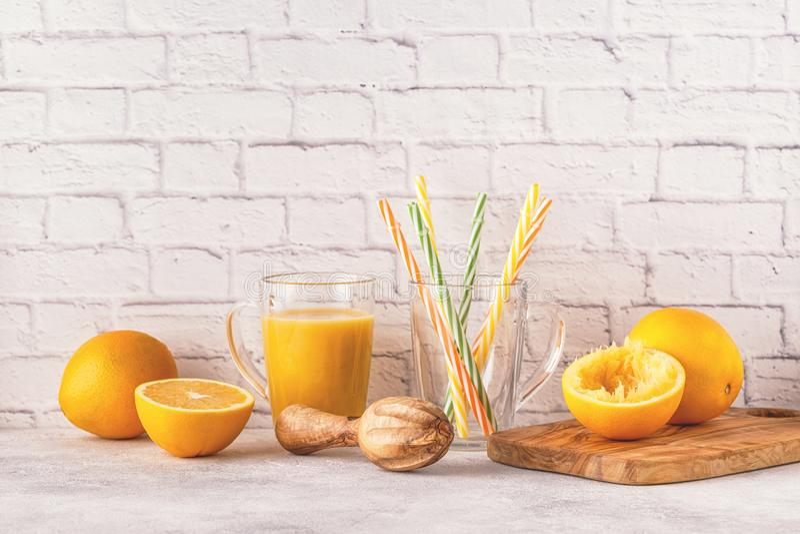 Oranges and juicer for making orange juice. stock photo