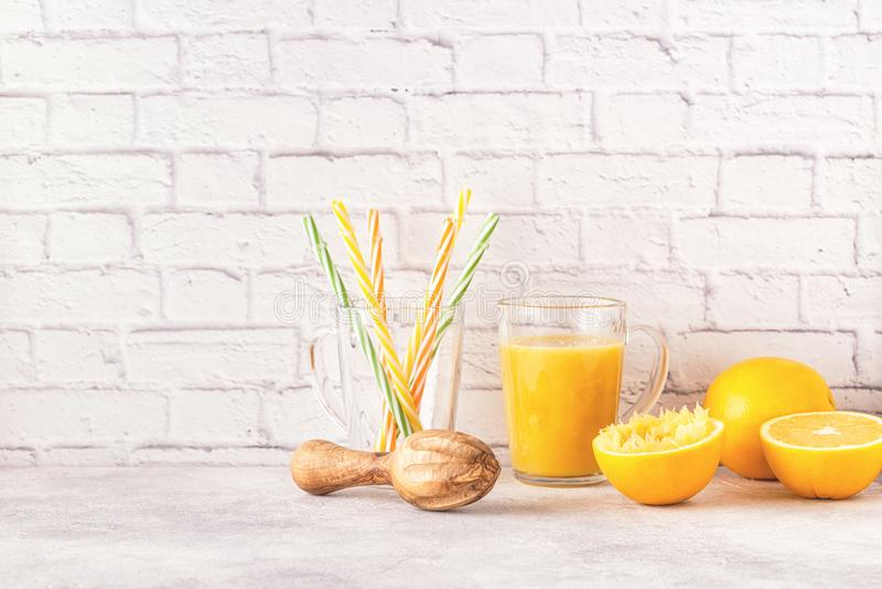 Oranges and juicer for making orange juice. royalty free stock photo