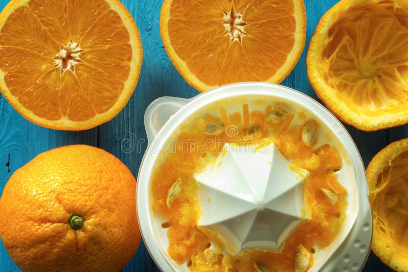 Oranges with juicer stock photos