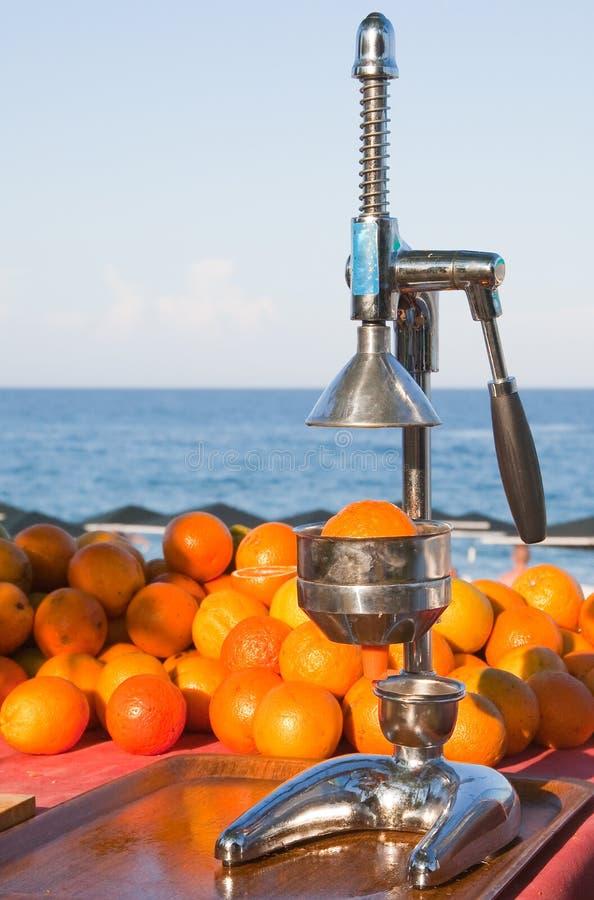 Oranges and manual press royalty free stock photos