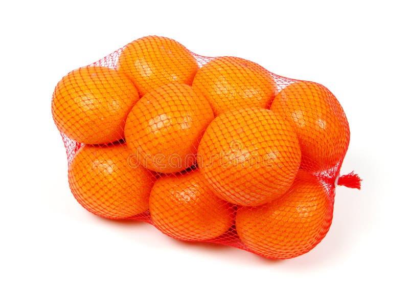 Oranges in net stock images