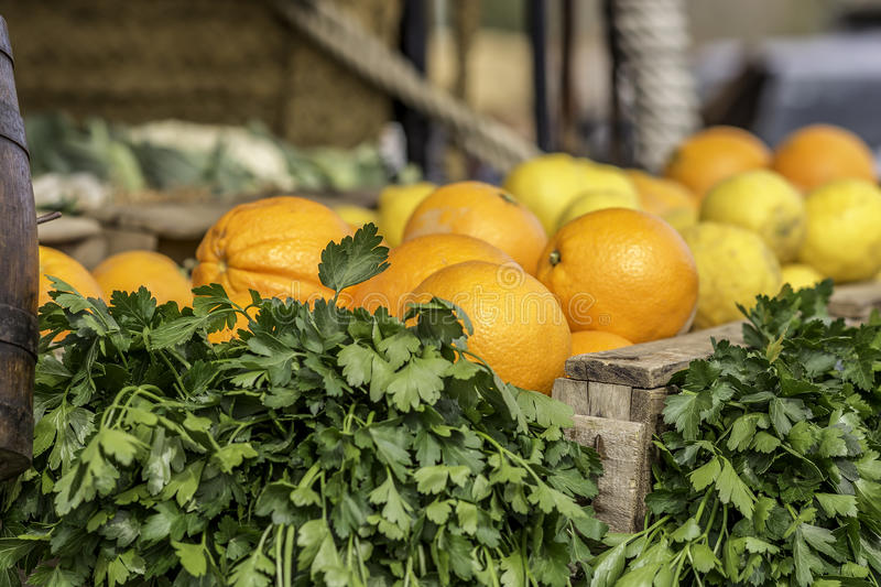 Oranges and parsley. Into a wood case stock photography