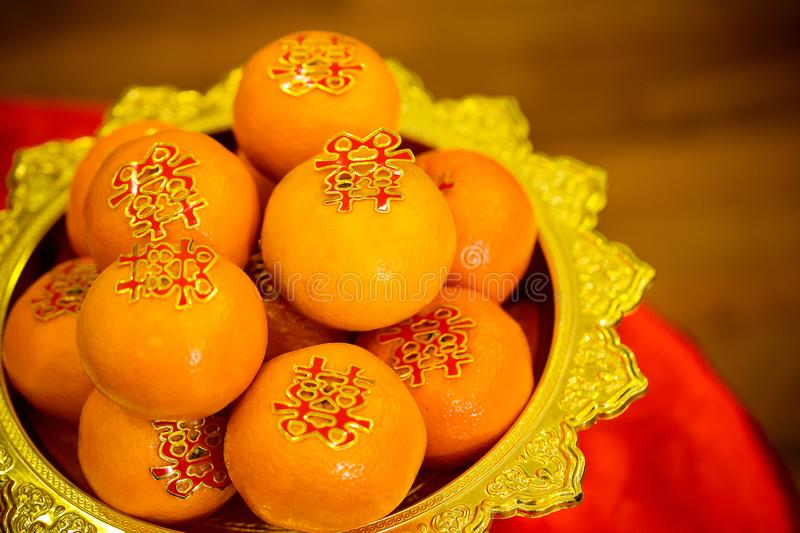 Oranges pile, on gold plated for worship in the Chinese New Year.chinese New Year`s Eve Celebration. stock photo