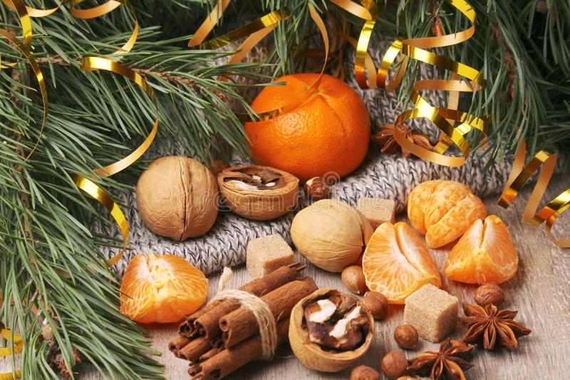 Still life composition formed with pine branches and New Year sweets. Oranges and pine branches form flat still life background for Christmas and New Year royalty free stock photography