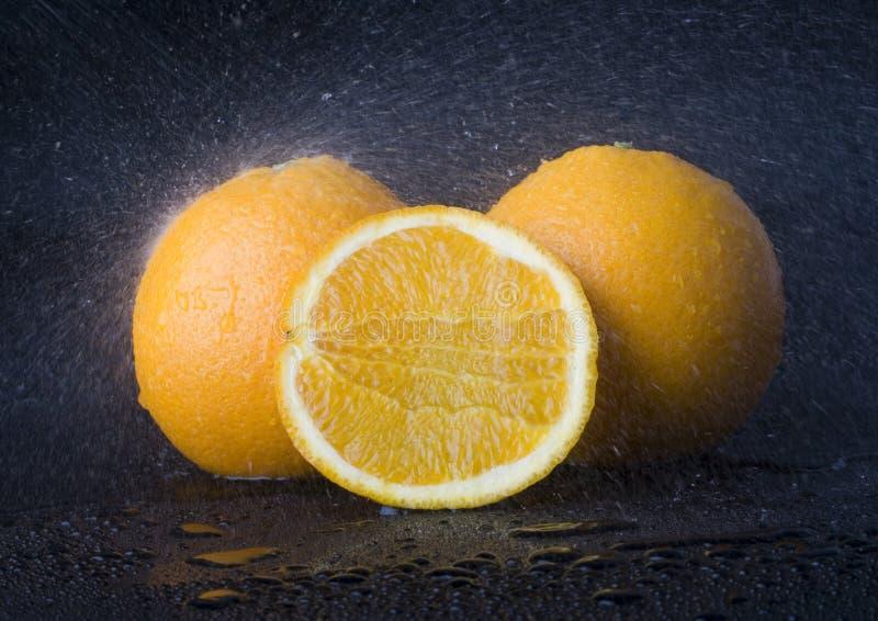 Oranges sous la pluie photographie stock libre de droits