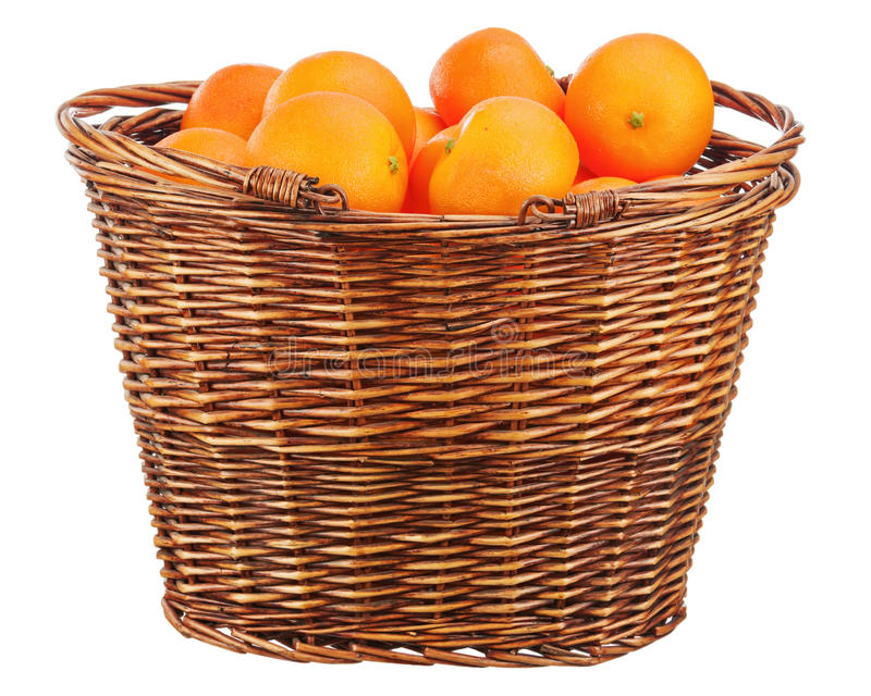Oranges in wicker basket isolated on white. stock image