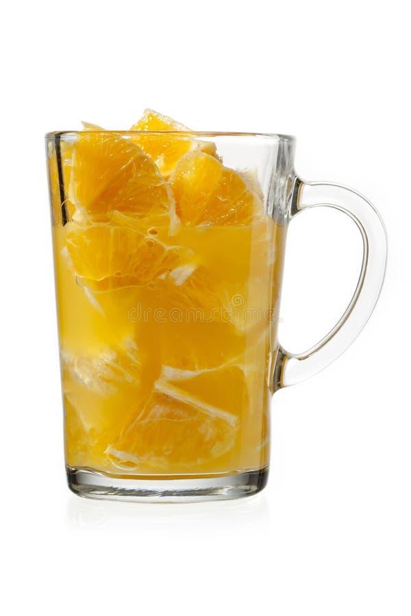 Orangeträmassa och fruktsaft i exponeringsglas arkivfoto