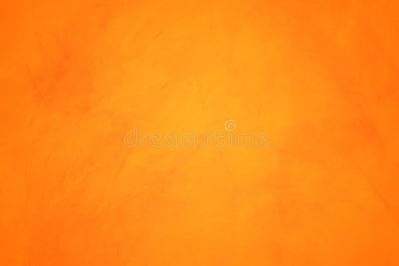 Oranje abstracte textuur als achtergrond Spatie voor ontwerp stock foto