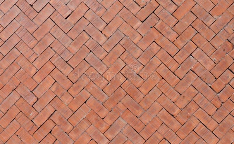 Oranje bakstenenvloer stock afbeelding