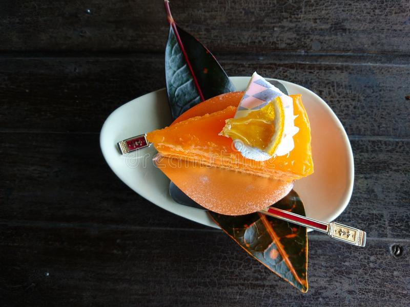 Oranje cake stock afbeelding