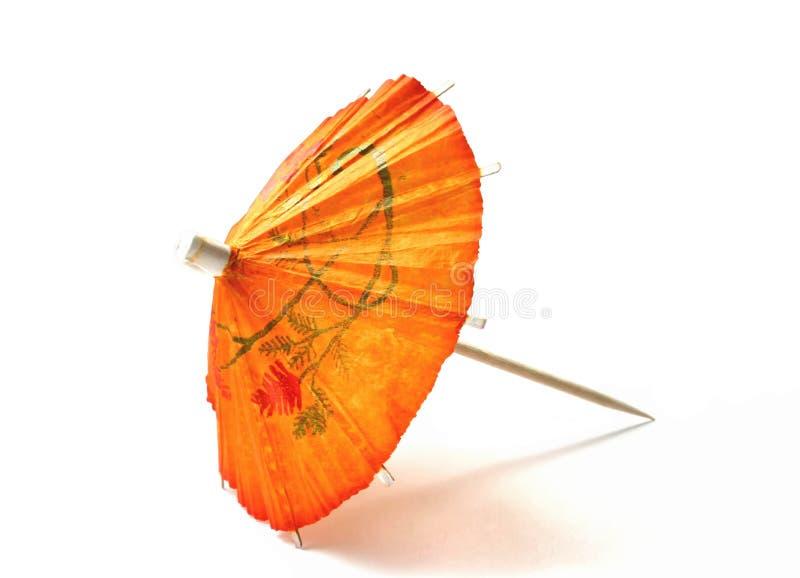 Oranje cocktailparaplu royalty-vrije stock afbeeldingen