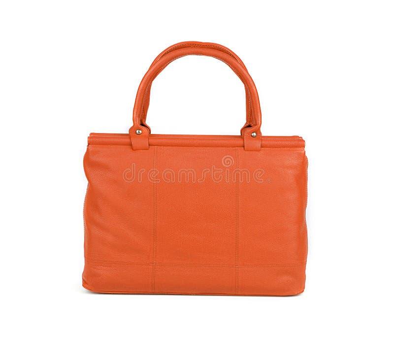 Oranje die vrouwenzak op wit wordt geïsoleerd stock foto's