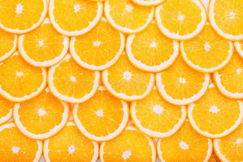Oranje fruitachtergrond De zomersinaasappelen Gezond stock fotografie