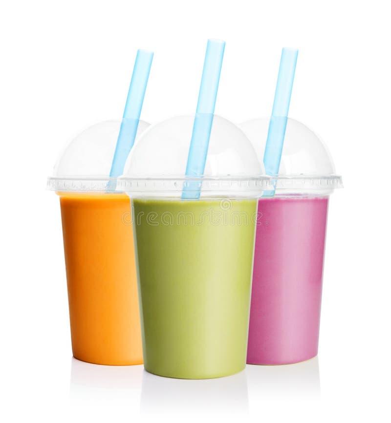 Oranje, groene en purpere smoothie stock afbeeldingen