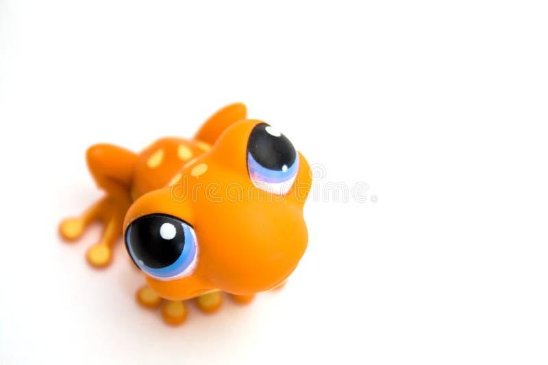 Oranje kikkerstuk speelgoed stock fotografie