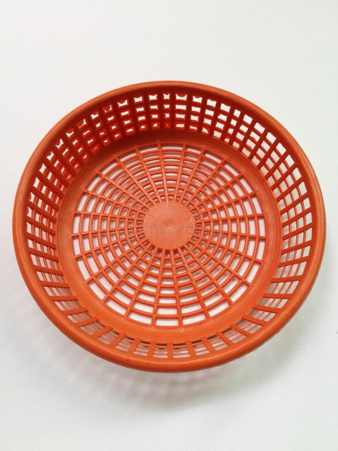 Oranje kleine plastic mand royalty-vrije stock foto